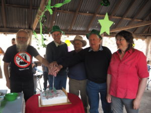 Some of the original Cactus Warriors cutting the cake